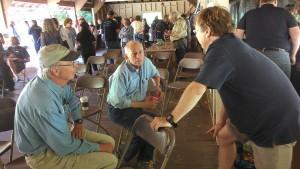 Hal Cohen, center, and Matt Soper, right, discuss the Float the Boat campaign.