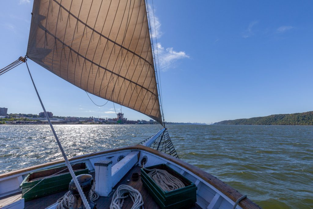 A photo of the Hudson River Sloop Clearwater's foredeck while sailing on a clear, sunny day on the Hudson River near Yonkers. Photo by Alon Koppel